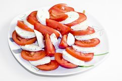 Tomatoes with mozarella on a plate Stock Photography