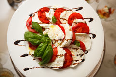 Tomatoes with Mozzarella Stock Photos