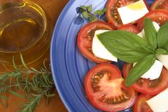 Tomatoes and mozzarella. Tomatoes with mozzarella and olive oil stock images