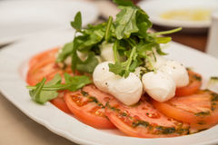 Tomatoes Mozzarella and Arugula Royalty Free Stock Images