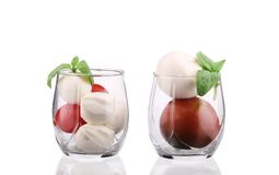 Tomatoes and mozzarella balls in glass. Stock Photo