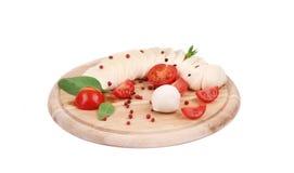 Tomatoes and mozzarella balls. Royalty Free Stock Photos