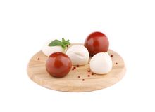 Tomatoes and mozzarella balls. Royalty Free Stock Photography