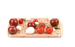Tomatoes and mozzarella balls. Stock Image