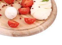 Tomatoes and mozzarella balls. Royalty Free Stock Image