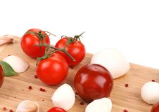 Tomatoes and mozzarella balls. Stock Image