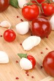 Tomatoes and mozzarella balls. Stock Images