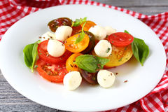 Tomatoes and mozzarella balls - salad Royalty Free Stock Photography