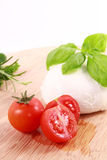 Tomatoes mozzarella and basil Stock Photos