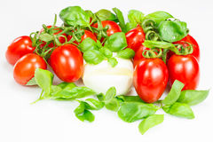Tomatoes, mozzarella and basil Stock Photo