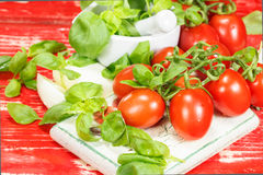 Tomatoes, mozzarella and basil Stock Photos