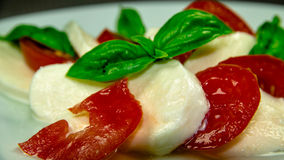 Tomatoes, mozzarella, basil Stock Images