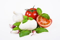 Tomatoes, mozzarella, basil and garlic Royalty Free Stock Image