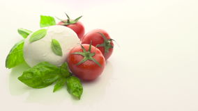 Tomatoes, mozzarella and basil stock video footage