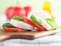 Tomatoes with mozzarella and basil Royalty Free Stock Image