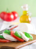 Tomatoes with mozzarella and basil Stock Images