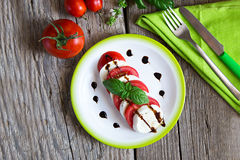 Tomatoes and Mozzarella chease slices with fresh basil Stock Image