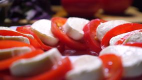 Tomatoes and mozzarella cheese salad close up video stock video footage