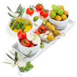 Tomatoes, mozzarella and olive oil Stock Images