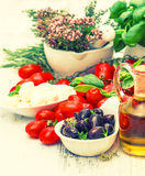 Tomatoes, mozzarella and olive oil. Caprese salad ingredients Stock Images