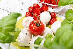 Tomatoes and mushrooms. Cherry tomatoes and some Paris mushrooms Royalty Free Stock Images