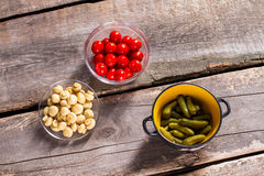 Tomatoes and mushrooms with pickles. Royalty Free Stock Photos