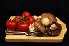 Tomatoes and Mushrooms Stock Photos