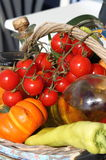 Tomatoes, oil and fresh vegetables Stock Photography