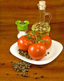 Tomatoes, oil and salt on the table Royalty Free Stock Image