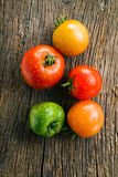 Tomatoes on old wooden table Royalty Free Stock Photos