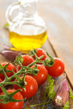 Tomatoes with olive and garlic. On the wooden table Stock Photo