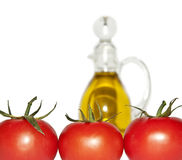 Tomatoes and olive oil Stock Image