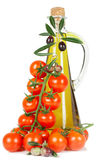 Tomatoes and olive oil Stock Photography