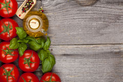 Tomatoes and olive oil Stock Images