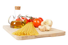 Tomatoes, olive oil, garlic and spaghetti Stock Photography