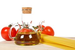 Tomatoes, olive oil, garlic and spaghetti Stock Photo