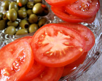 Tomatoes and Olives Stock Images