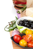 Tomatoes, olives, parmesan cheese, herbs and spices Stock Photography