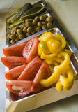 Tomatoes and olives plate Royalty Free Stock Photography