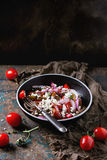 Tomatoes and onion salad Stock Photos