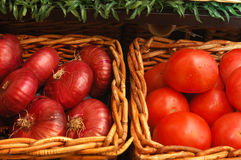 Tomatoes, onions in a basket. Royalty Free Stock Images