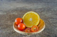 Tomatoes  and orange Stock Photography