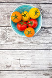 Tomatoes, orange, yellow and red, bowl Royalty Free Stock Photography