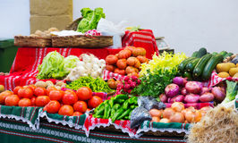 Tomatoes and other vegetables on   counter Royalty Free Stock Photo