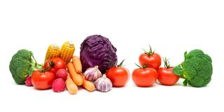 Tomatoes and other vegetables on a white background. Horizontal photo Royalty Free Stock Images