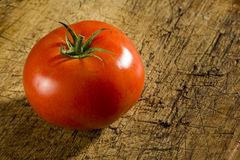 Tomatoes over wood Royalty Free Stock Image