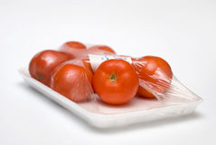 Tomatoes in the package. Eight fresh tomatoes in the package Stock Images
