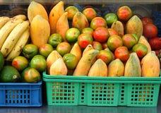 Tomatoes and Papayas and Bananas. Fresh produce such as tomatoes, papayas and bananas at an outdoor juice stand Royalty Free Stock Photo