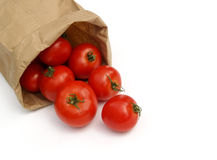 Tomatoes in a paper bag Royalty Free Stock Images