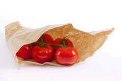 Tomatoes in paper bag Stock Images